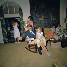 The Kennedys in Florida, the First Lady heading to the window to smoke.