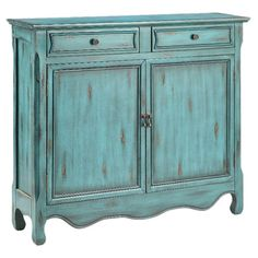 Pairing a hand-painted blue finish with its classic silhouette, this artful cabinet brings lovely style to any room. 2 doors open to ample storage, perfect f...