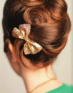 Adorable upstyle accented with super sweet glittered bow. Very sassy and fun for a vintage wedding look!