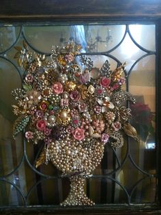 Leaded glass window embellished with an urn of jeweled flowers. Costume Jewelry Crafts, Vintage Jewelry Crafts, Recycled Jewelry, Jewelry Frames, Jewelry Tree, Button Art, Button Crafts, Jewelry Christmas Tree, Rhinestone Art