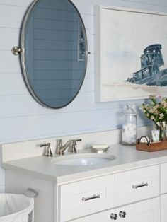 Covered in shiplap painted a coastal shade of blue-gray, the master bath with an inviting shower, freestanding roman tub and double vanity offers the ultimate space for relaxation and rejuvenation.