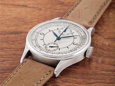 PHILLIPS : CH080215, Patek Philippe, An extremely rare and important oversized stainless steel single button chronograph wristwatch with vertical registers, sector dial and pulsometer-scale
