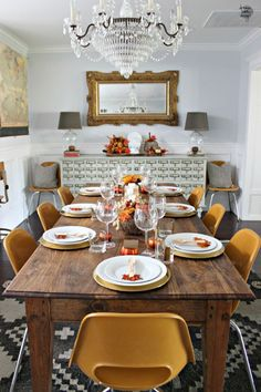 Sometimes all you need for a beautiful holiday table are pops of orange and gold.  Get the tutorial at Dream Book Design.   - CountryLiving.com