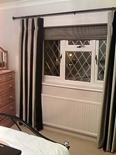 Triple pleat curtains on Pole with contrast Roman blind in recess