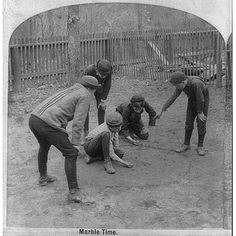 Did you learn how to play marbles growing up?   Photo courtesy of the Library of Congress.  #History #bwphotos #kids #playing #vintage #historicalphotos #ancestry #genealogy #familyhistory #familytree #heritage #roots #playti