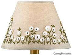 freshen up an old lampshade, simply glue or sew on some buttons. Place buttons in a pattern or simply make a random design, glueing in place. In this lamp additional detail has been added with embroidery thread. Diy Buttons, Vintage Buttons, Button Art, Button Crafts, Button Lampshade, Old Lamp Shades, Lace Curtains, Bedroom Curtains, Sisal