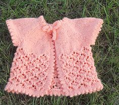 Baby Cherry Blossom is the second is a blossom series. Apple Blosom Cardigan is the first. This adorable baby cardigan is knit in one piece. The only sewing is done when you sew down the picot edges.