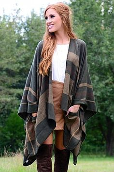 Suede skirt with plaid poncho for a layered look for fall.