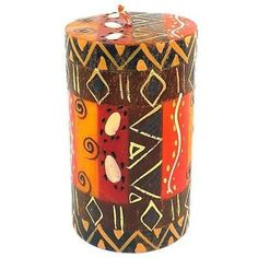 This pillar candle, hand-painted by South African artisans, arrives in a recycled cardboard gift box. The candle is 4 inches tall by 2 inches in diameter.