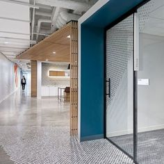 The Podcasts To Know | Modern office space featuring neturals and a pop of blue. | #TheWorkMode | #officedesign #officedecor #workplacedesign #workplace
