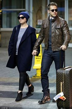 Jet-set family: Ginnifer Goodwin showed off her baby bump as she landed in Vancouver on Monday with her husband Josh Dallas