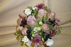 Memory lane roses with viburnum berries, astrantia and mini pittosporum in a brides handtied design