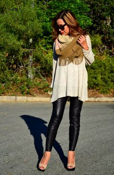 Chunky knit scarf and light sweater are the perfect pairing for leather leggings.
