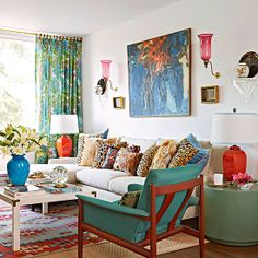 Color!! And those pillows! This is so much fun. And I love the decorating trick of layering rugs.