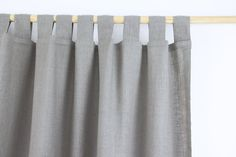 Tab Top Linen Curtain Panel / NATURAL LINEN COLOR / homey style / linen drapes. This listing is for ONE NATURAL LINEN tab top linen curtain panel. By covering windows with airy curtains, you can soften the light and protect the room from the sun, while your interior still remains bright. Linen curtains gives cozy, fresh and natural look to your home. TAKING CARE: - washable at 40 °C - avoid wringing when washing by hand - avoid using bleach containing chlorine - use fabric softeners...