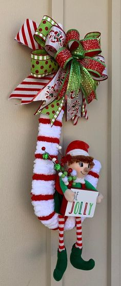 Terrific Pic Cute Christmas Wreath, Candy Cane Wreath, Elf Wreath Suggestions hristmas is probably the most loved of breaks when everyone gets something, therefore we've to ch Ribbon On Christmas Tree, Christmas Door Decorations, Easter Wreaths, Holiday Wreaths, Holiday Crafts, Merry Christmas, Christmas Ornaments, Xmas Crafts To Sell, Christmas Picks
