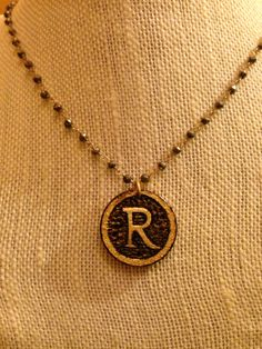 "BurnedinBrooklyn wooden ""R"" pendant on 14kt gold filled Marcasite chain. https://www.etsy.com/shop/BurnedinBrooklyn"