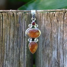 SUNSTONE Pendant with Garnet Accent ~ 925 Silver ~ Copper Schiller ~ Feldspar ~ Solar Plexus Chakra by FireFlashGems on Etsy https://www.etsy.com/listing/472451784/sunstone-pendant-with-garnet-accent-925