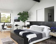 Courteney Cox's Malibu Home - ELLE DECORThe cabinetry and mirror frame in Courtney Cox's master bath are ebonized white oak, the pendant lights are custom made, and the sink fittings are by Waterworks; the chair and ottoman are upholstered in a velvet by Rose Tarlow Melrose House, and the artwork was done by Cox's father while he was in high school.