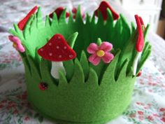 felt grass basket with flowers, ladybugs, and toadstools