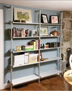 AS SEEN IN THE WALL STREET JOURNAL Semi-Wall Mounted Two Bay Pole Mounted Aluminum Shelving System. Mount the Semi-Wall Mounted Design to your wall by attaching two tie pole kits per pole.  Place the shelf end supports at any height to support your aluminum shelves. The aluminum shelves offer two 31