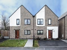 Within Grove, Huncoat, Accrington. The development contains a mix of 2, 3 and 4 bedroom affordable housing units for rent. Built on behalf of Contour Housing Association to Level 3 of the Code for Sustainable homes. Croft Goode Architects.
