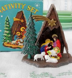 All of us kids had our own little Nativity scene. They usually had a glitter covered roof. (I still have mine)