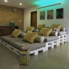 Home theater idea - painted pallets and futon cushions!