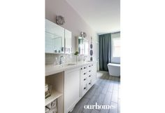 A custom vanity with double sinks sits on porcelain floors that mimic hardwood. See more at http://www.ourhomes.ca/articles/build/article/rusticmodern-clutterfree-and-familyfriendly