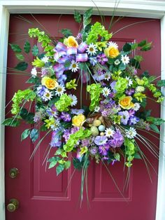 Beautiful Spring wreath for the front door. I would love to have this on my front door!!