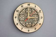 Wood carved wall clock Russian ornament by LVwoodworks on Etsy, $30.00 (lots of different carving patterns)