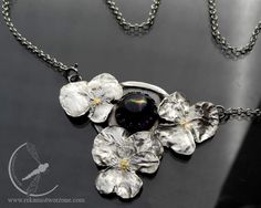 Silver necklace based on 3 real #violas covered with silver, which surround an #amethyst. The insides of the violas are gold plated.  #tamborska #rekamistworzone #rekami_stworzone #art_jewelry #art_nouveau_inspired #art_nouveau_jewelry #secesja #nowa_secesja #bratki #ametyst