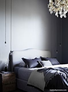 The master bedroom is painted in Resene Rolling Stone, a stormy green-edged grey. http://www.habitatbyresene.co.nz/tracie-and-davids-brooding-belgian-style