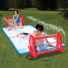 """This is the backyard game that lets two players square-off in a sliding, water-soaked game of knee hockey. Thirty tiny nozzles built into both sides of the rink spray 24"""" high fountains of water that saturate the surface and players, ensuring ecstatic slipping and jockeying for control of the oversized plastic puck. $50"""
