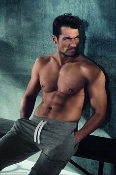 David Gandy kicks off the new year by showcasing his sizzling six-pack modelling his new l...