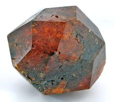 SPESS-36 Spessartine Garnet Loliondo, near Serengeti National Park, Tanzania Small Cabinet, 6 x 5.7 x 5.2 cm 282 grams and complete! A textbook crystal of SUPER SHARP faces and edges, with an unusual dark wine-red color. It is pristine and complete all around save only a small contact at one bottom face, with some translucency at the edges but generally dark. However, in a case, it looks wine-red and the sheer size and sharpness of form carry the day for display value.