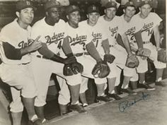 """""""This is a photo of the players that represented the Brooklyn Dodgers in the 1952 All Star game. Carl Furillo, Jackie Robinson, Roy Campanella, Pee Wee Reese, Duke Snider, Preacher Roe, and Gil Hodges."""" Whoa, talk about some heavy hitters!"""