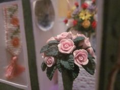 Nov. 30, 2014 - This pink rose plant stands in a white ceramic pot; it came from the Dollshouse Emporium.  It was just the right height to sit in front of the paper flowers without blocking them from view.