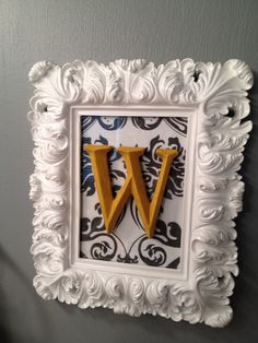 Framed fabric with initial/love this! white frame, yellow letter, blue bird print..