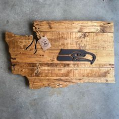 Handcrafted from reclaimed wood in Lynden, WA, this Washington State Seattle Seahawks Wood Sign was artfully created by Conor Larkin of Larkins Woodshop.  Get your home ready for game day and represent your 12th Man pride! Our Washington State Seahawks Sign is easily wall-mounted by its hanging wire.  We are passionate about loving where you live and appreciating the beauty of the community you are a part of. To us, Washington state is home, and we couldnt love it more. The trees, the…