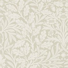 Pure Acorn Wallpaper A pretty monotone wallpaper, originally designed in 1879, and featuring a beautifully pared back representation of acorn branches created using the original wooden Morris & Co. hand printing blocks. Shown in ecu on an ecru ground.
