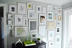 from young house love. I think that gallery walls can either contain colorful imagery with frames that are all a homogenous color OR they can be many different kinds of frames but the imagery should be black and white.