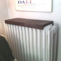 Need to get! Wooden radiator cover shelf, simple and nice looking- plus maximizes space! The dark wood looks nice on the white radiator.                                                                                                                                                                                 More