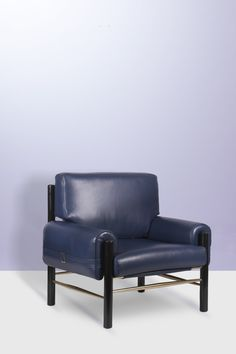 Inspired by the cultural icon James Dean, this leather upholstered armchair has a slender boxy look and curvy arms, and expresses, somehow, his role in his most celebrated film: Rebel Without a Cause. Its frame construction is classic, made of lacquered wood and polished brass, giving it an unmistakable characteristic of a lounge chair.