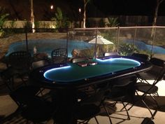 Amazing view of Pool and backayrd for your guest as they play on a Deluxe Casino Table. LED Lights brighten the Night, No Plug Necessary. DADS Poker Night Casino Party Rentals