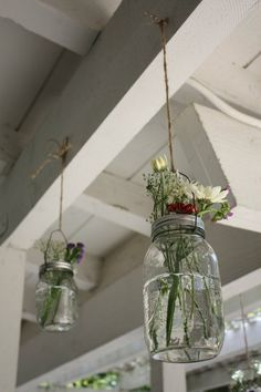 These are super cute!! They are little glass jars with pretty flowers hanging (or sitting) on the middle of tables...