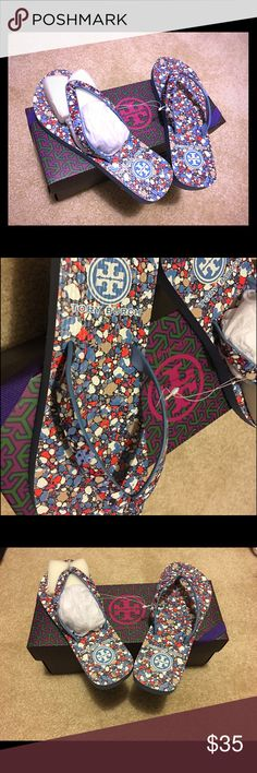 Tory Burch printed flip flops Size 5 NWT Brand new in box confetti printed thin flip flops with a light blue base color and logo on strap. Extremely comfortable and great for summer. Tory Burch Shoes Sandals