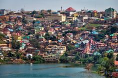 If you wish to meet the #easternlowlandgorilla, you will likely sleep here, on one of the colourful peninsulas of #Bukavu. This intellectual capital of #Congo's #LakeKivu may well be the prettiest city of Eastern and Central Africa. But its contrasts are stark: modern speedboats and dugout #canoes, elaborate soaring rooflines and terrible dusty roads, mineral wealth and ironic poverty. The #DRC is a remarkable place!  #RDC #eastafrica #centralafrica #gorilla #lowlandgorilla #grauersgorilla #kahu City Gallery, Canoes, Speed Boats, East Africa, Republic Of The Congo, Roads, Wealth, Mineral, Countries