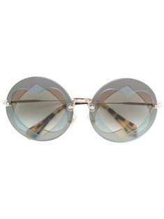 cf2d9210c79c MIU MIU EYEWEAR .  miumiueyewear   Heart Shaped Sunglasses