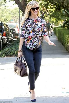 Fresh in florals: Reese Witherspoon radiated as she stepped out in a flower printed blouse in Santa Monica, California on Thursday